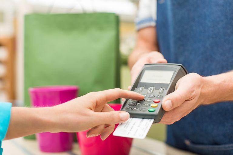 settings Female Entering PIN Number In Credit Card Reader
