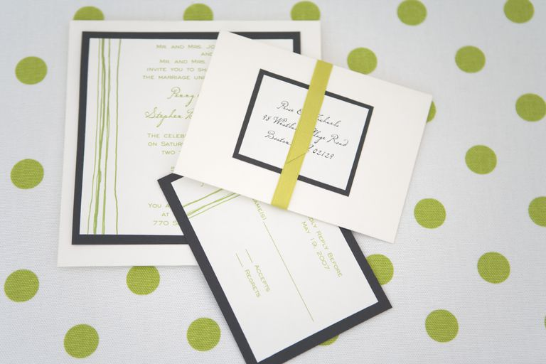 Wedding invitations on polka dot background