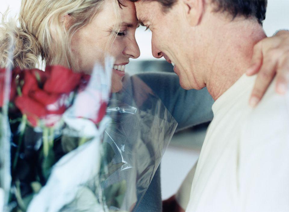 Husband and wife embracing
