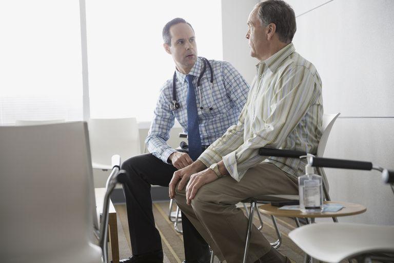 Doctor talking to senior man