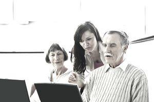 Three people studying Social Security benefits