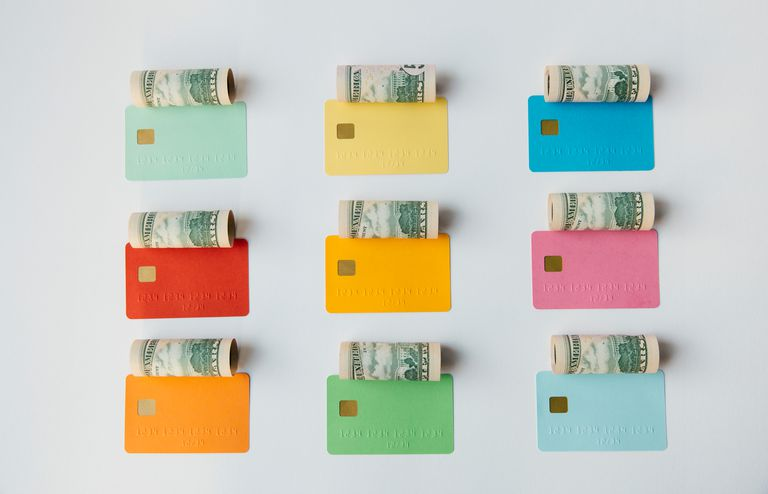 Credit cards and money in rows