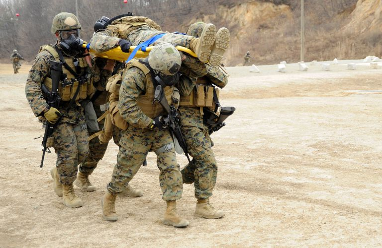U.S. Marines carry a fellow Marine on a stretcher while conducting tactical movement training at Camp Rodriguez, South Korea.