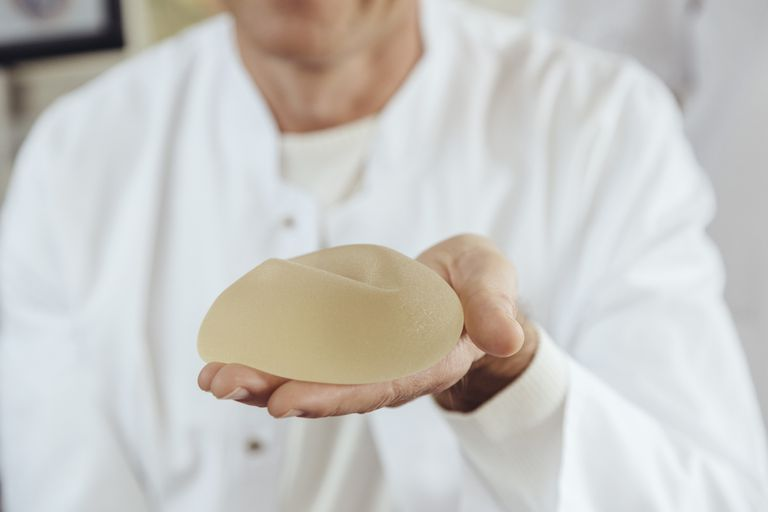 Doctor showing a silicone breast implant