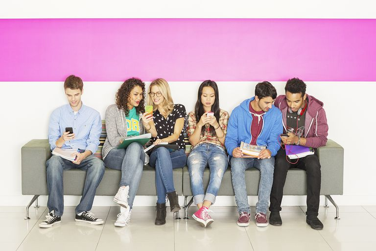 University students sitting on bench