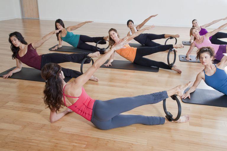 A class uses the Pilates magic circle.