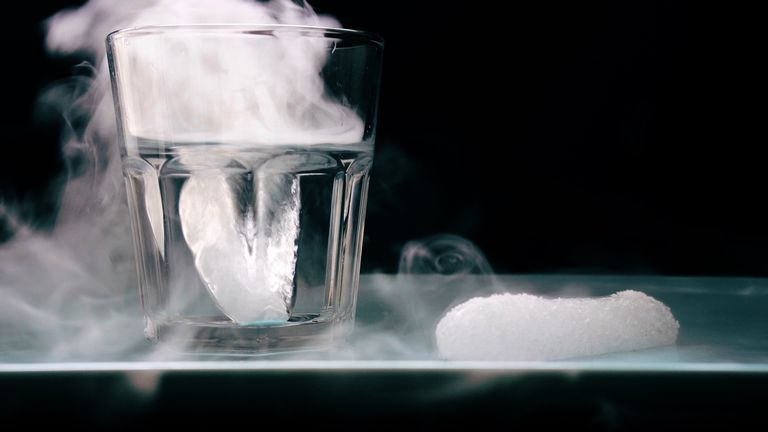 This is a glass of water with dry ice, showing the fog, and a chunk of dry ice sublimating in air. The fog comes from water vapor cooled by the dry ice.