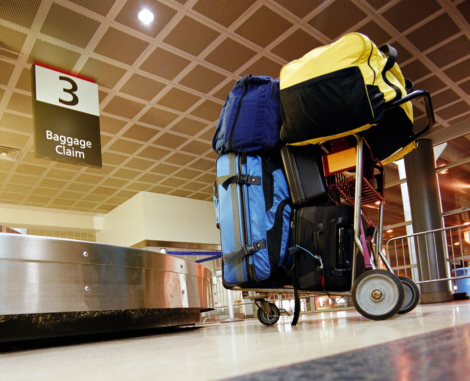 Luggage cart and carousel in airport