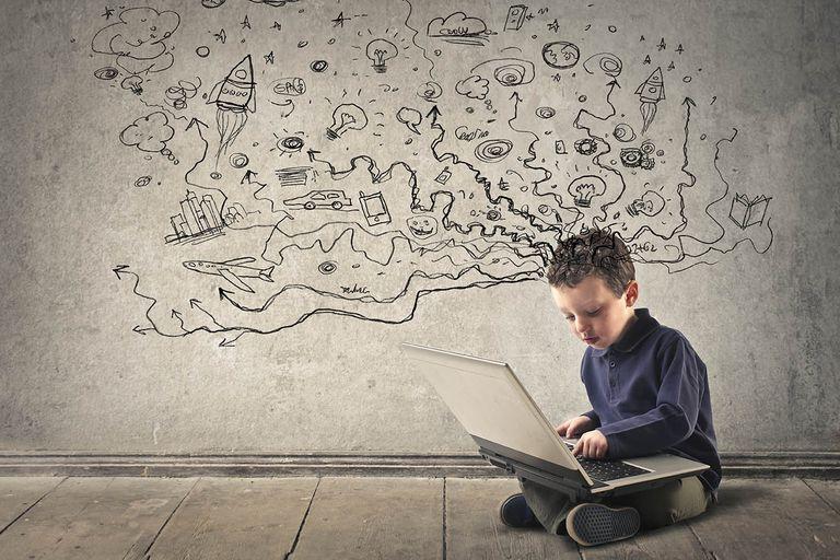 Boy using a computer and thinking big