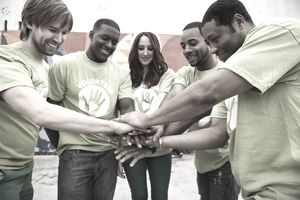 Volunteers holding hands in circle