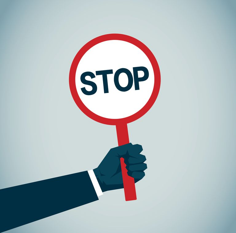 Illustration shows an arm holding a stop sign.
