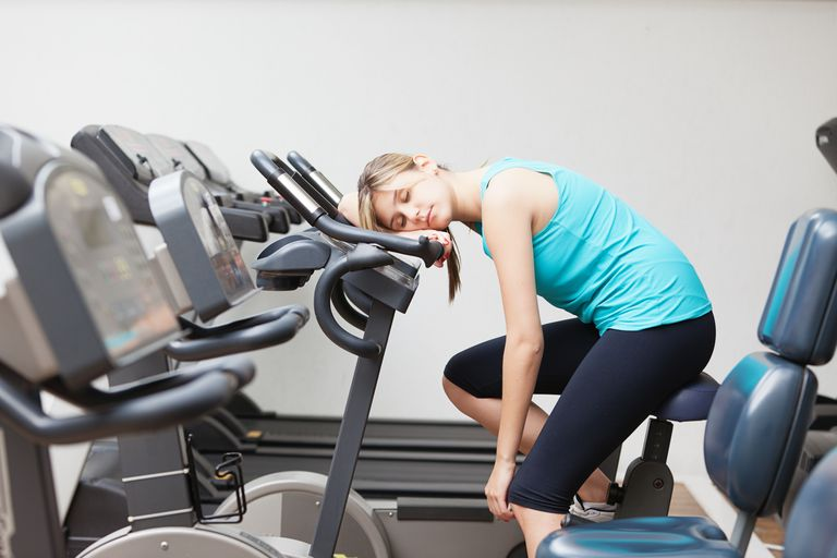 Woman napping on an exercise bike