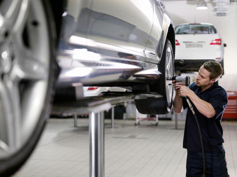 Mechanic working on car
