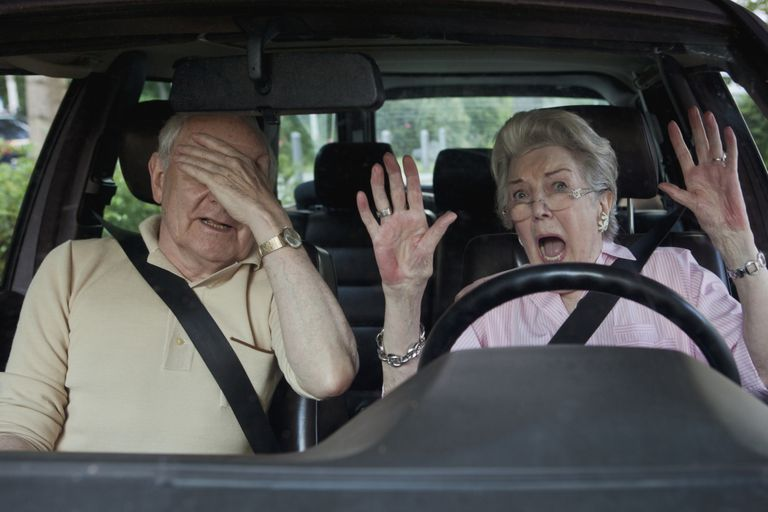 Two older people freaking out in a car