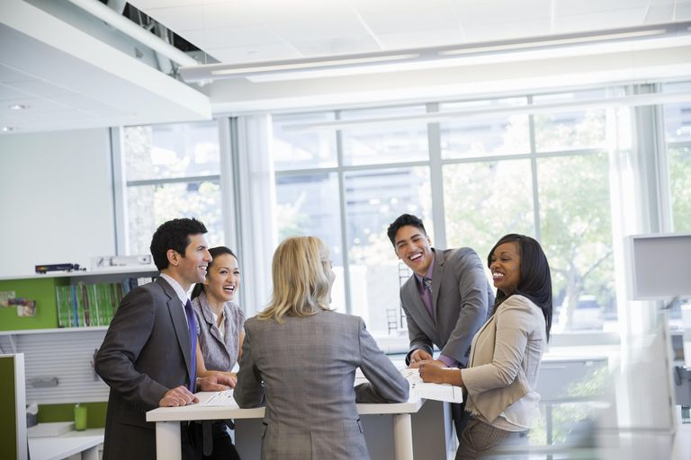 Business team laughing together at office