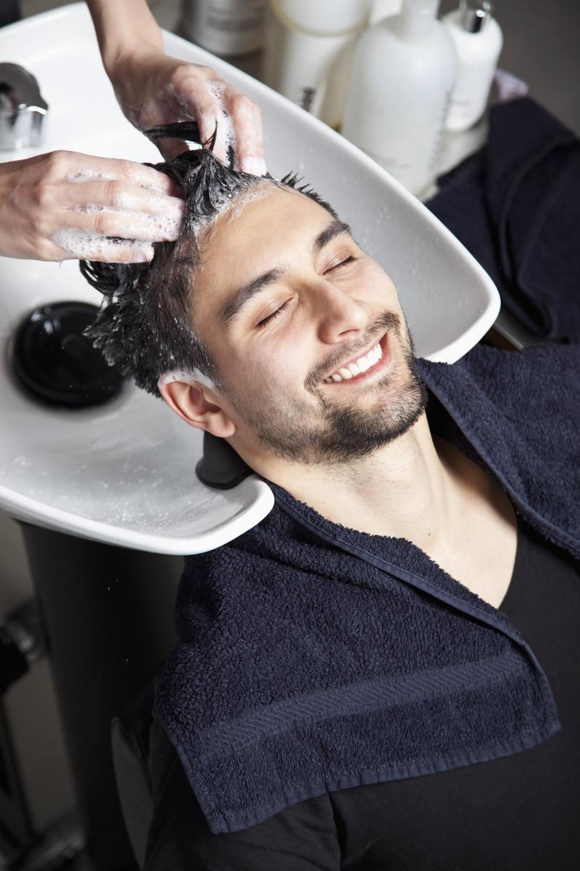 A man having his hair washed at a hair salon