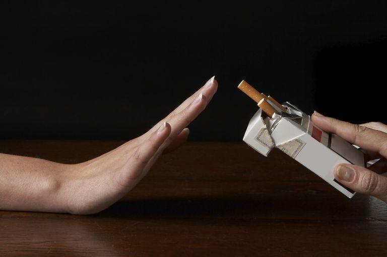 hand refusing to take a cigarette