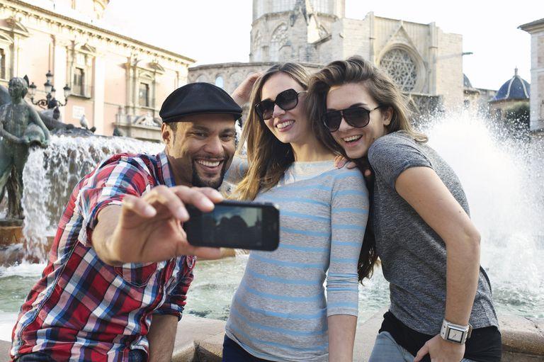 three friends taking selfie on vacation