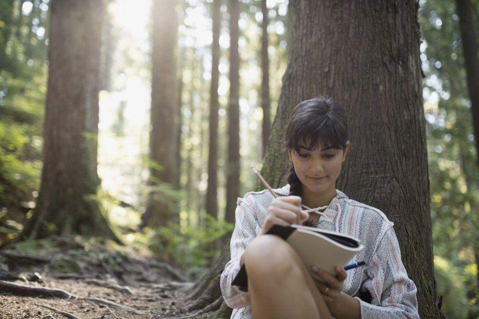 Woman keeping bird journal