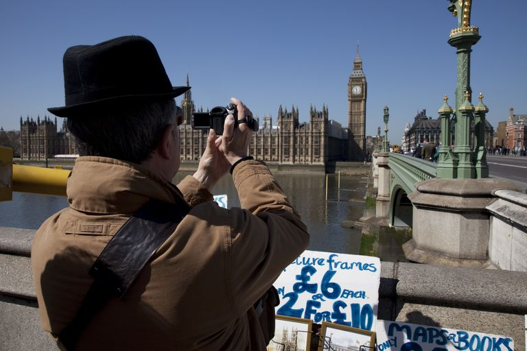UK - London - Tourist films Houses of Parliament on his camcorder