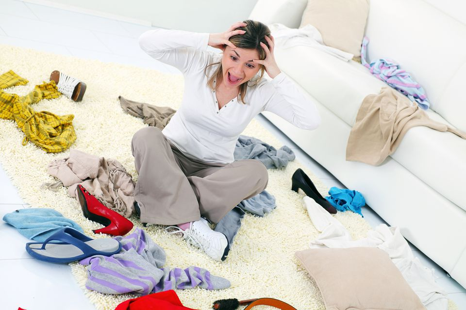 Woman surrounded by mess