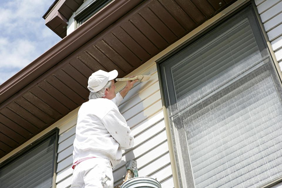 House Painter painting the outside of a house