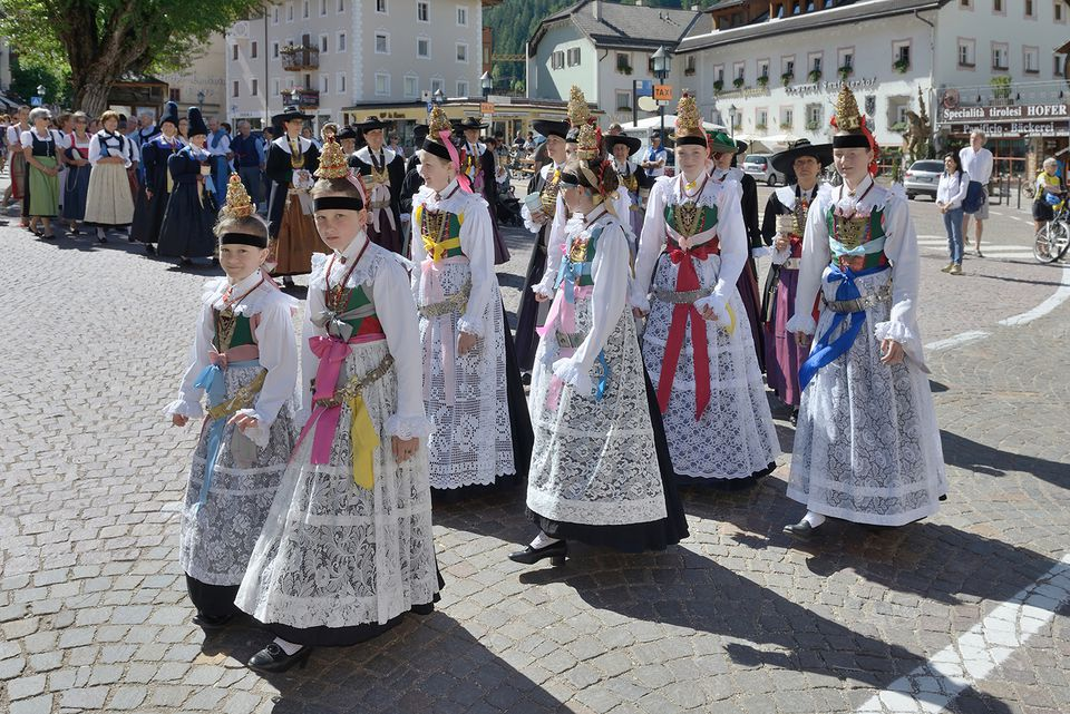 Young ladies in the traditional Gröden costumes at the procession of Corpus Christi.