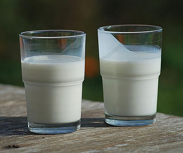 This photo compares the appearance of milk (left) and buttermilk (right).