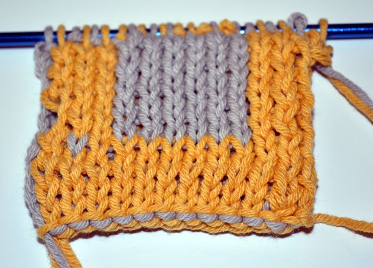 The colored square is taking shape (don't mind the miscolored stitch; it's practice!).