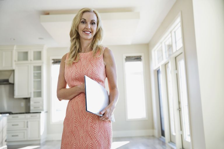female real estate agent in home