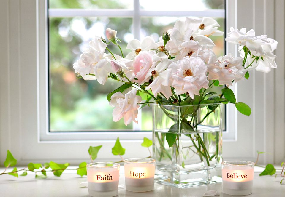 flowers and candles near the window
