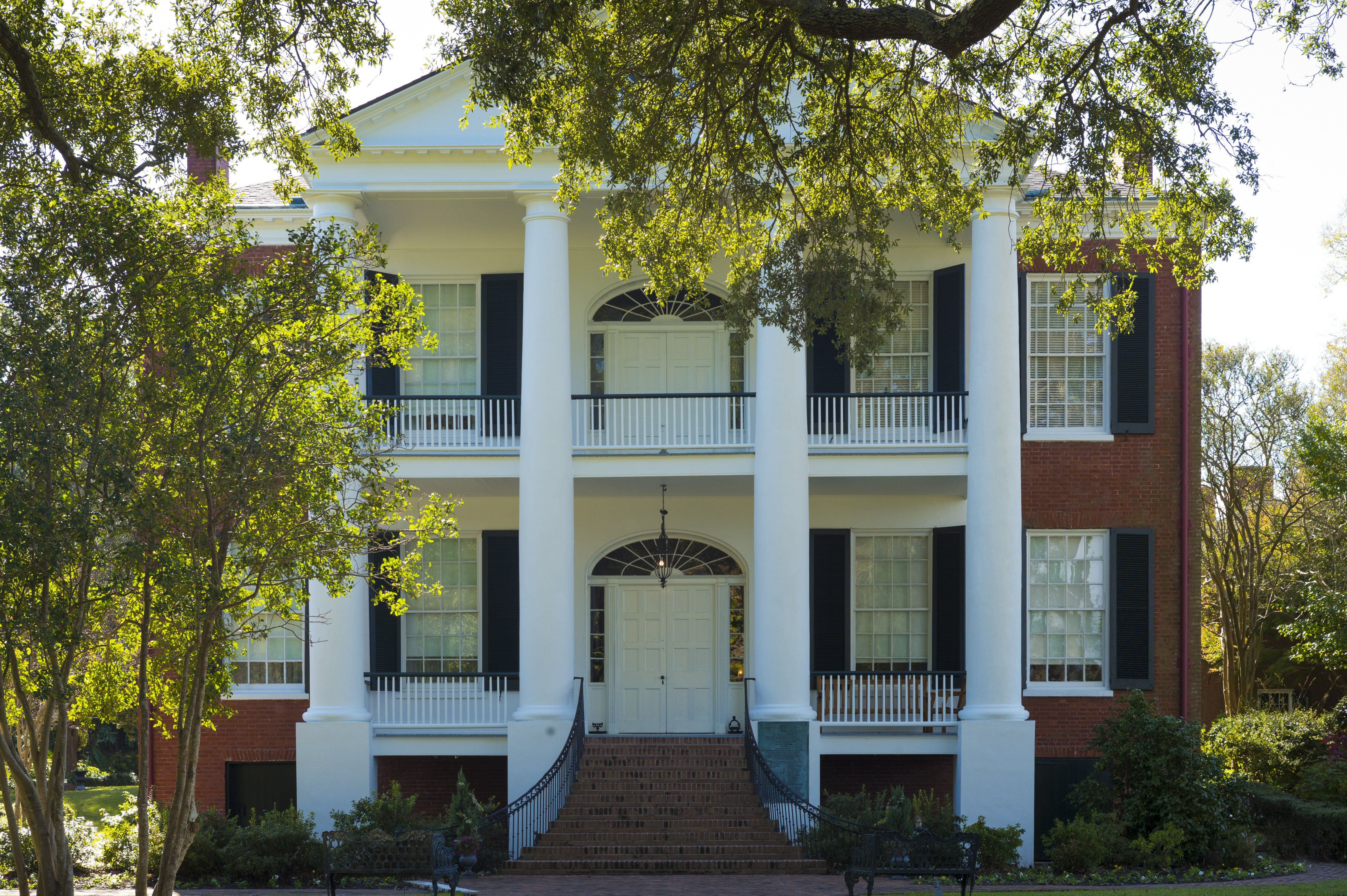 4 Tuscan Columns Rise To Pediment Over Two Front Porches On A Brick 2