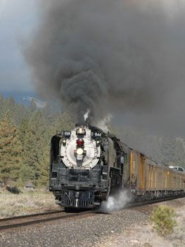 UP 844 steam locomotive picking up speed near Portola, CA