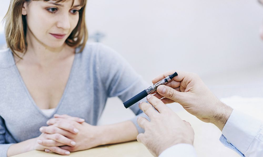 Doctor informing a female patient about e-cigarette