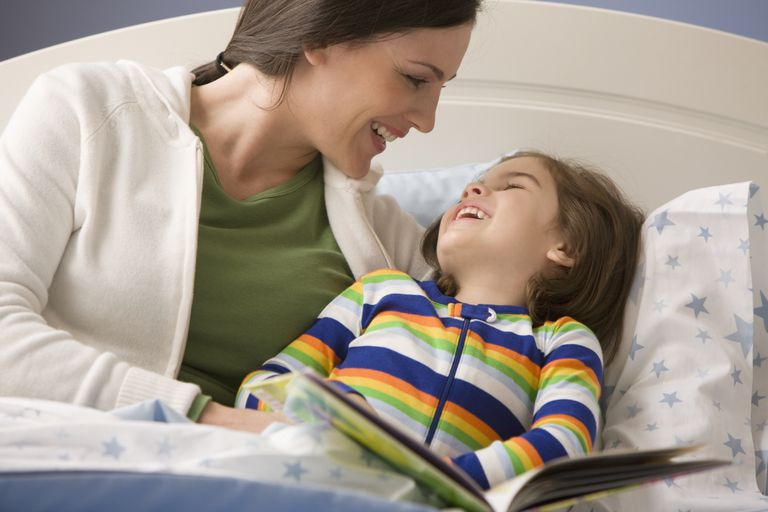 Mom and daughter laughing at bedtime