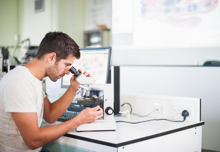 Medical students with microscopes