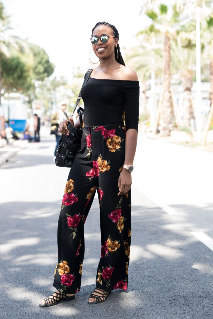 Woman in soft pants with floral print and black top