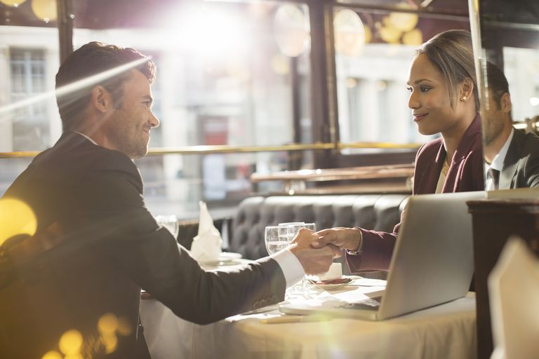 Business people shaking hands in a restaurant