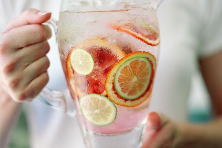 Add sliced fruit to a pitcher or water