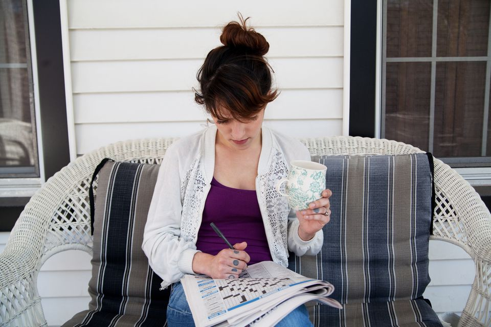 Young woman doing a crossword