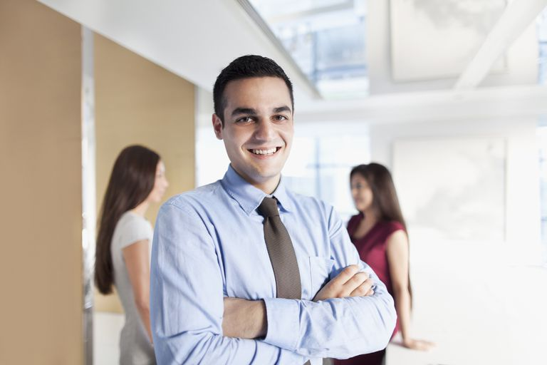 Portrait of young man in Asian business office