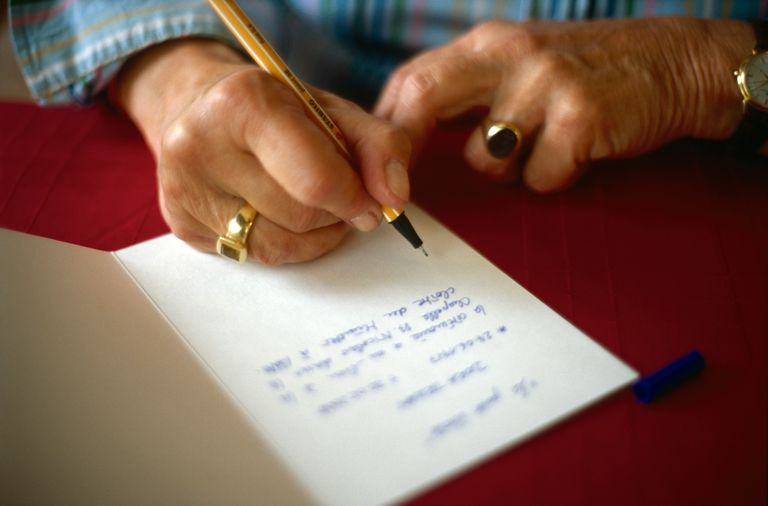 woman hand writing a card