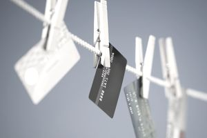 Credit cards hang from a clothesline