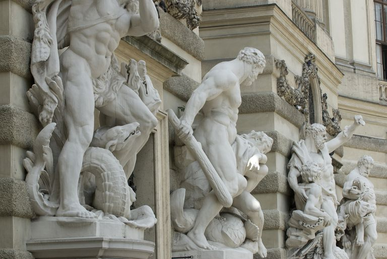 Entrance to the Imperial Palace in Vienna guarded by grandiose statues of heroic figures