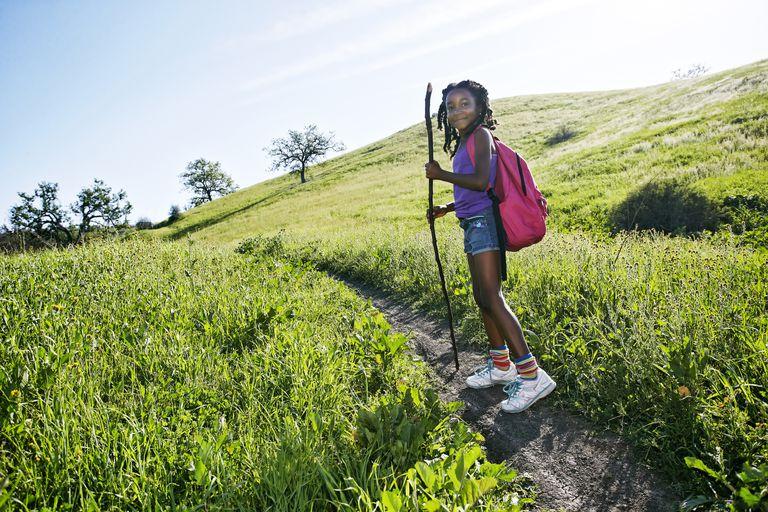 Hiking with kids - girl walking on rural path