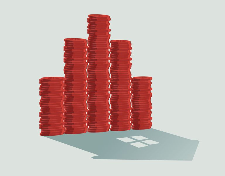 Stack of coins with house shadow