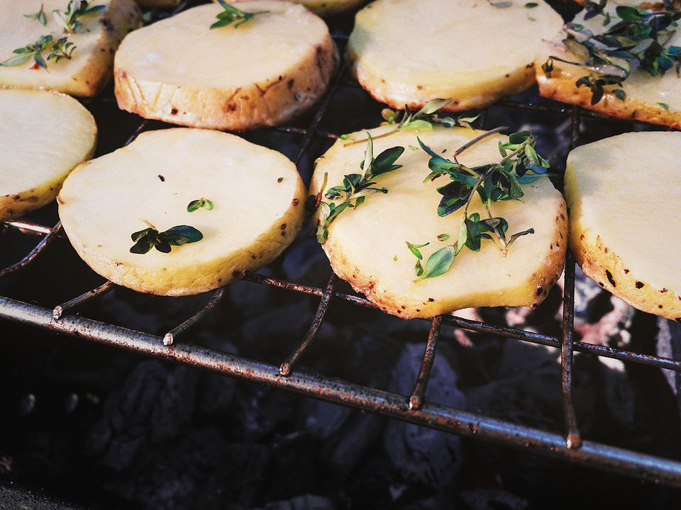 High Angle View Of Potatoes On Barbecue Grill