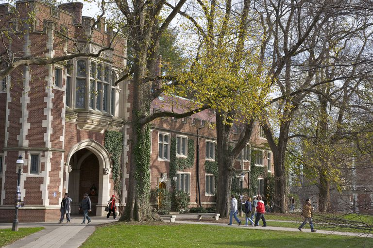 Students walking to classes near building in the Collegiate Gothic style, Princeton University, Princeton, NJ, USA