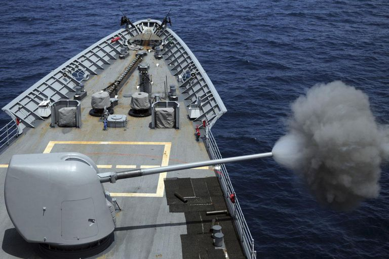 Atlantic Ocean, July 30, 2013 - The guided-missile cruiser USS Philippine Sea (CG-58) fires its MK 45 5-inch lightweight gun.