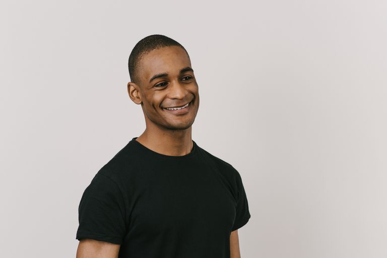 Portrait of black man with short hair